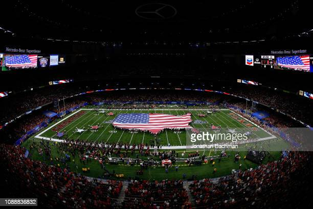An American flag is seen during the national anthem before the Allstate Sugar Bowl between the Georgia Bulldogs and the Texas Longhorns at the...