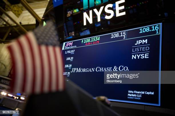 An American flag is seen in front of a monitor displaying JPMorgan Chase Co signage on the floor of the New York Stock Exchange in New York US on...