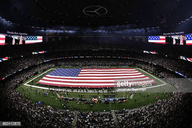 An American flag is seen on the field prior to a game between the New Orleans Saints and the Oakland Raiders at MercedesBenz Superdome on September...