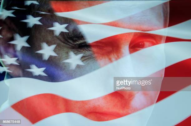 An American flag is seen with a portrait of Russian president Vladimir Putin in this photo illustration on October 31 2017 Material posted on Facebok...