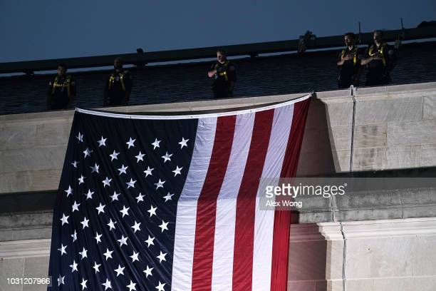 An American flag is unfurled down the side of the Pentagon to mark the 17th anniversary of the 9/11 terror attacks September 11 2018 in Arlington...