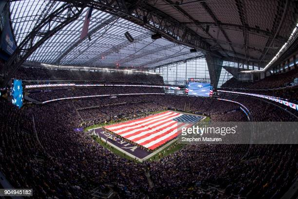 An American Flag is unfurled during the signing of the national anthem before the NFC Divisional Playoff game between the Minnesota Vikings and New...