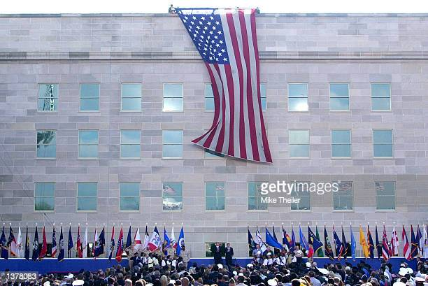 An American flag is unfurled from the top of the Pentagon over the reconstructed section which was damaged by American Airlines flight 77 September...