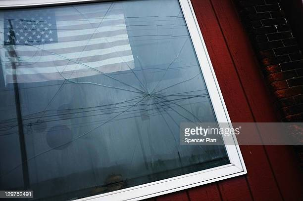 An American flag is viewed in a window in downtown Reading on October 19, 2011 in Reading, Pennsylvania. Reading, a city that once boasted numerous...