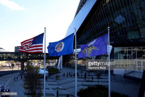 An American flag, Minnesota State flag and Minnesota Vikings flag flies outside U.S. Bank Stadium, home of the Minnesota Vikings in Minneapolis,...