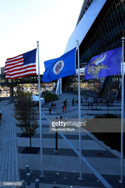 An American flag, Minnesota State flag and Minnesota Vikings flag flies outside U.S. Bank Stadium, home of the Minnesota Vikings in Minneapolis,...