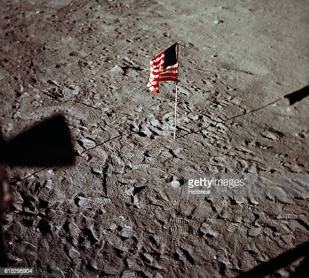 An American flag on the Moon placed by the Apollo 11 astronauts Footprints from the astronauts are visible all around the flag Apollo 11 was the...