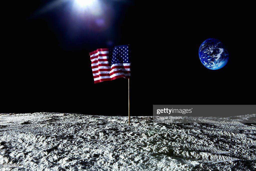 An American flag on the surface on the moon : Stock Photo