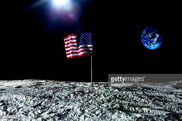 an american flag on the surface on the moon - moon stock pictures, royalty-free photos & images