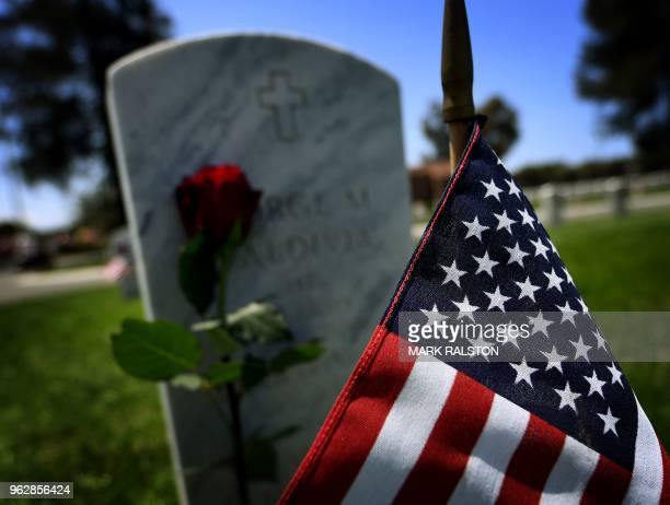 An American flag one of the 88000 placed beside graves of veterans at the Los Angeles National Military Cemetery is seen two days before Memorial Day...