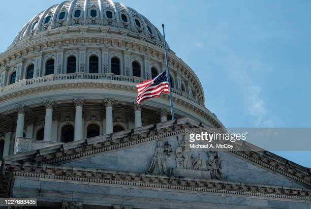 An American flag outside of the U.S. Capitol lowered to half staff to honor the life of Rep John Lewis on July 18, 2020 in Washington, DC. John...
