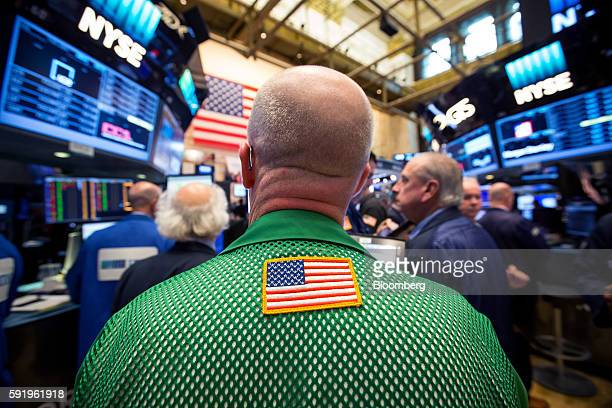An American flag patch is seen on the back of a trader's jacket at the New York Stock Exchange in New York US on Friday Aug 19 2016 US stocks slipped...