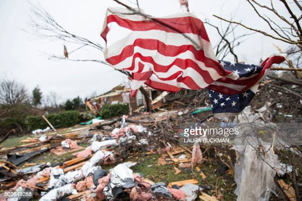 TOPSHOT An American flag placed by first responders is seen December 27 2015 in the aftermath of a tornado in Rowlett Texas At least 11 people lost...