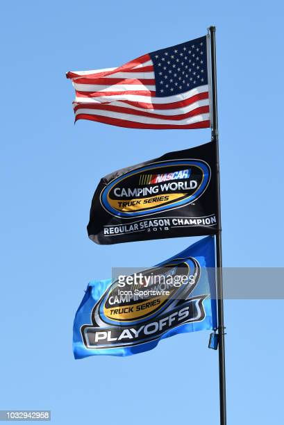An American flag regular season champion flag and a playoff flag are displayed above the hauler of Johnny Sauter Allegiant Chevrolet Silverado during...