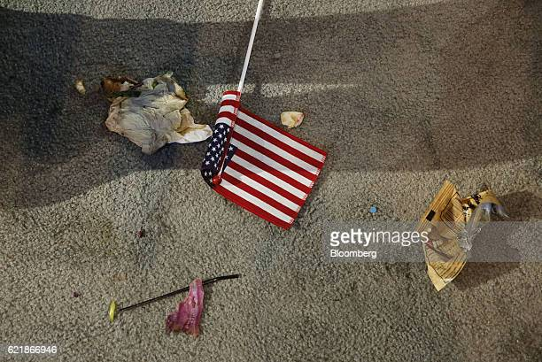 An American flag sits next to trash on the floor after an election night party for 2016 Democratic Presidential Candidate Hillary Clinton at the...