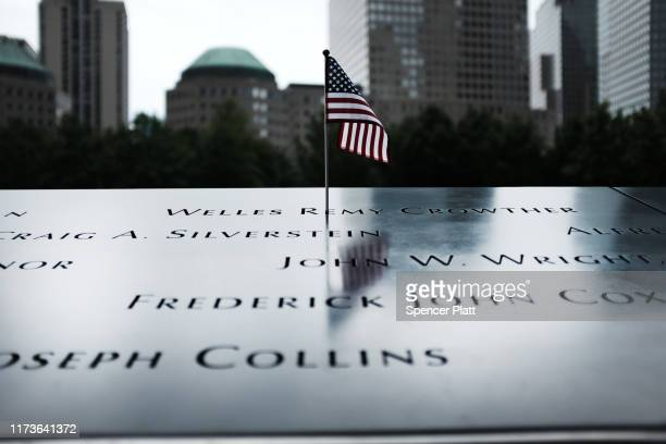 An American Flag stands in one of the names at the World Trade Center Memorial in lower Manhattan on September 10 2019 in New York City New York City...