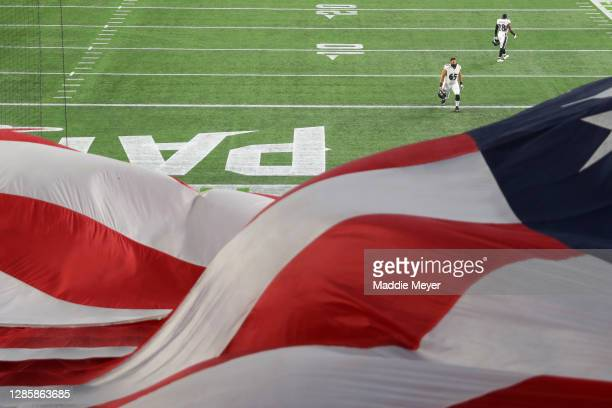 An American Flag waves as Patrick Mekari and Jordan Richards of the Baltimore Ravens take the field against the New England Patriots at Gillette...