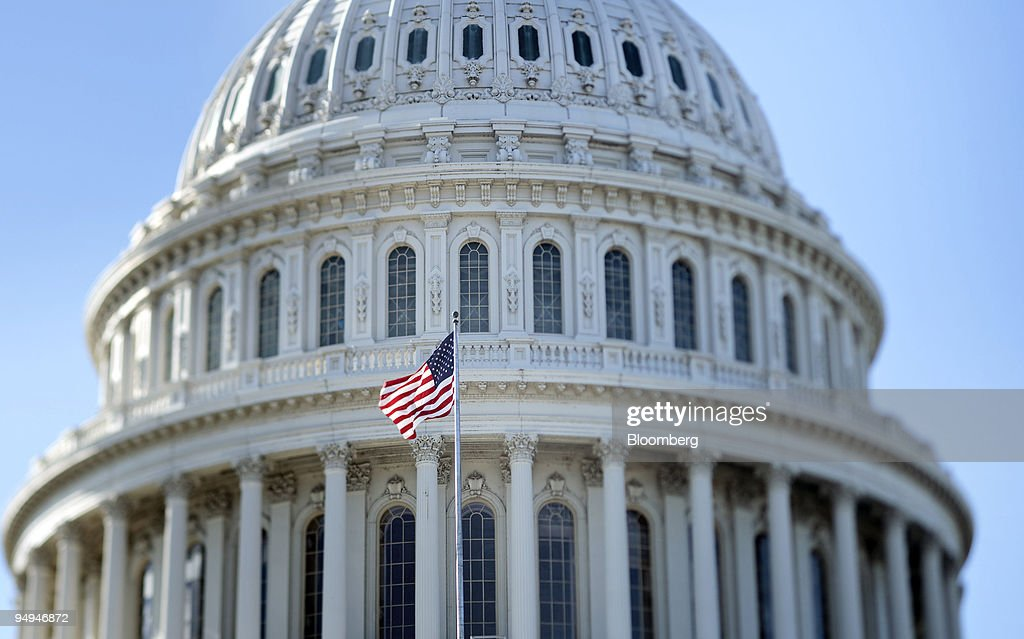 An American flag waves in front of the rotunda of the Capito : News Photo