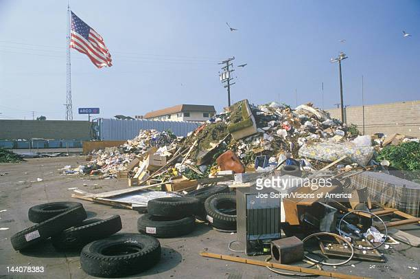 An American flag waving in the distance behind a dump site at the Santa Monica Community Center CA