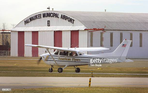An American Flyers Pilot Training School instructor and student taxi in their Cessna 172 singleengine plane January 7 2002 at Palwaukee Municipal...
