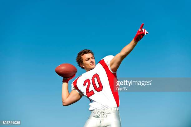 an american footballer lines up a throw. - american football uniform stock pictures, royalty-free photos & images