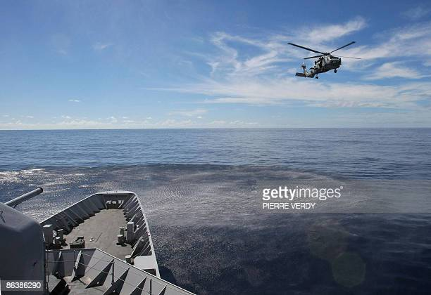 An american helicopter 'Seahawk' from the spanish warship 'Murcia' in command of EU's Atalante antipiracy mission in the Indian Ocean flies around...