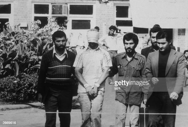 An American hostage being paraded before the cameras by his Iranian captors Following the Iranian revolution over fifty American hostages were taken...