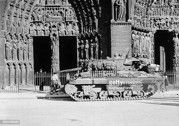 An American M10 tank with a 76 mm canon is posted in front of NotreDame cathedral a few days after the liberation of the city in August 1944 in Paris...