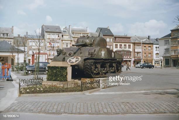 An American M-4 Sherman tank serves as a war memorial in McAuliffe Square in Bastogne, Belgium, circa 1960.