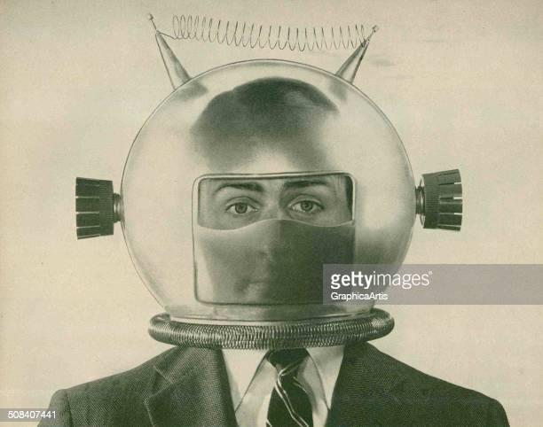 An American man in a suit wearing a strange fake space helmet, 1950s. Screen print.