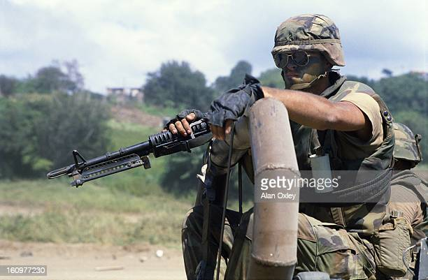 An American Marine in a military convoy near St Georges during the US invasion of Grenada in Oct 1983
