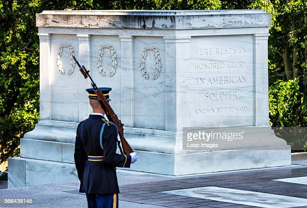 An American military officer passes the Guarded Tomb of the Unknown Soldier in Arlington Cemetery