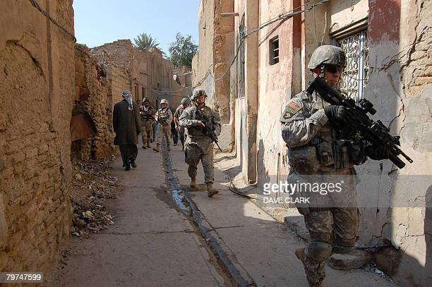 An American military training team and their Iraqi army colleagues conduct a foot patrol in the historic centre of the city of Samarra on February...