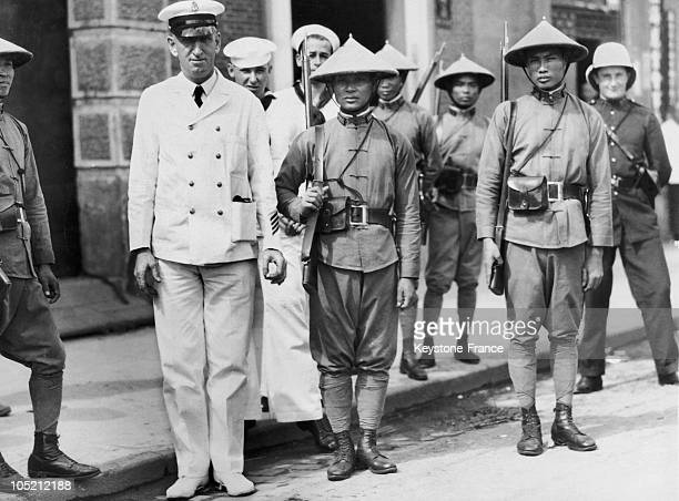An American Naval Officer With Sailors Behind Him Posing In The Company Of Chinese Police Officers Who Guard The Foreign Concessions Of Shanghai In...