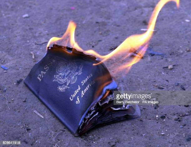 An American passport, belonging to James Derieg, formerly from New Mexico, USA, and now living in Cirencester, Gloucestershire, burns at the peace...