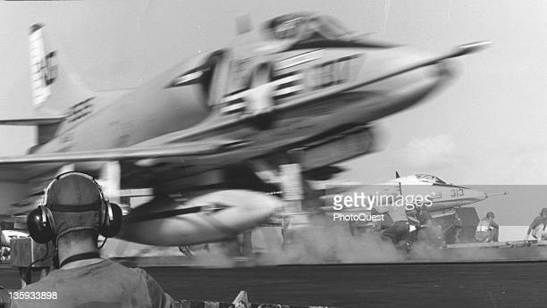 An American plane takes off from an unidentified US Task Force 77 aircraft carrier during a bombing mission over North Vietnam at sea March 1965