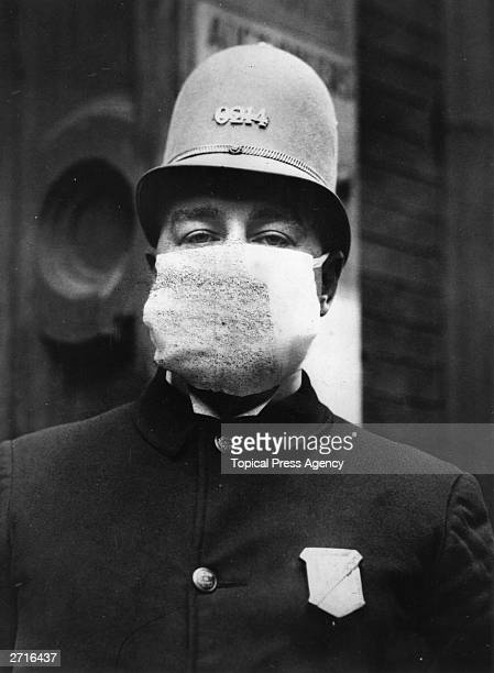 An American policeman wearing a 'Flu Mask' to protect himself from the outbreak of Spanish flu following World War I.