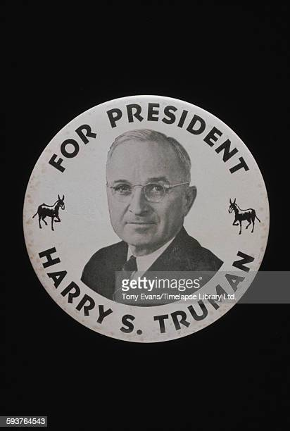 An American presidential election badge for Democratic candidate Harry S. Truman, 1948.