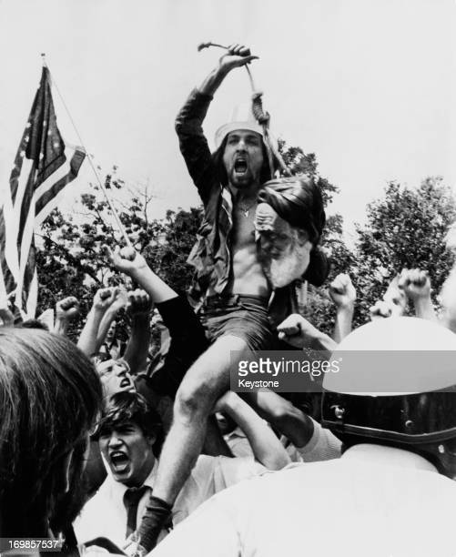 An American protestor holds a dummy head of Iranian leader Ayatollah Khomeini in a noose at a demonstration in Washington DC August 1980 The event is...