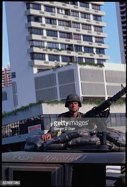 An American soldier patrols Panama in a humvee which has the words Feliz Navidad written on it The United States invaded Panama in December of 1989...