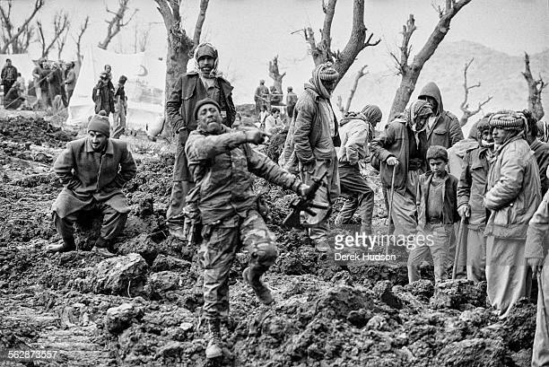 An American soldier remonstrates with Kurdish refugees as they await a food drop to the wasteland where an exodus of thousands of Kurds persecuted by...