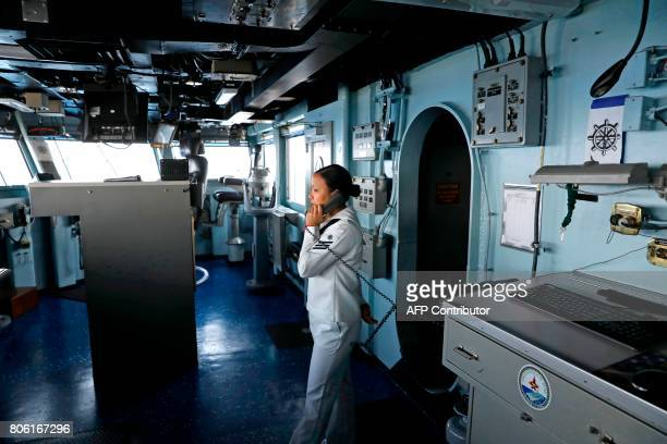 An American soldier speaks over the phone on the US aircraft carrier USS George H W Bush as it docks at the Haifa port on July 3 2017 / AFP PHOTO /...