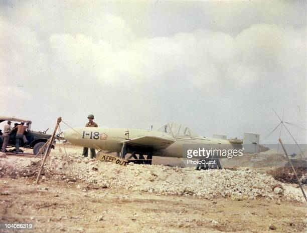 An American soldier stands guard over a roped-off Yokosuka MXY7 �Ohka� attack plane at Yontan airfield, Okinawa, Japan, April 13, 1945.