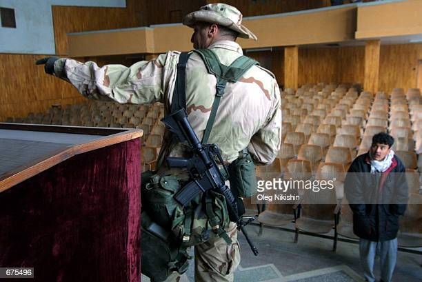 An American soldier stands in the auditorium of Balkh University December 4 2001 in Mazaresharif Afghanistan The university campus buildings are...