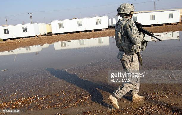 An American soldier walks around at the Taji base complex which hosts Iraqi and US troops and is located thirty kilometres north of the capital...
