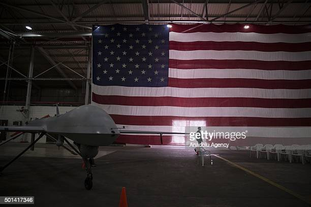 An American soldier walks past an American flag at Incirlik Air Base in Adana Turkey as US Air Force introduces war planes used in intervention...