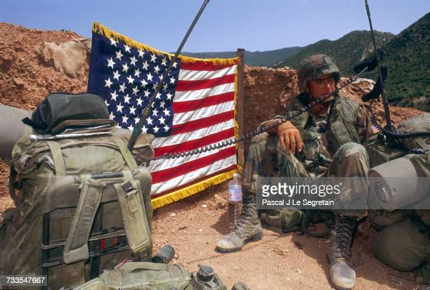 An American soldier with the 325th Airborne Infantry Regiment mans a flagadorned outpost near Dohuk Iraq In August of 1990 US forces were deployed to...