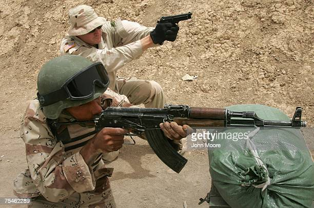 An American Special Forces soldier fires alongside an Iraqi recruit during an intense combat training course July 18 2007 in Baqouba Iraq Some 60...