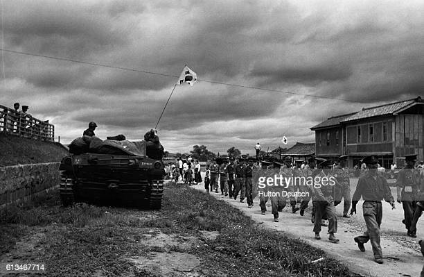 An American Tank Crew Watch Southern Koreans On The March Near Taejon. With the United Nations forces goung over to the offensive in Korea, Picture...