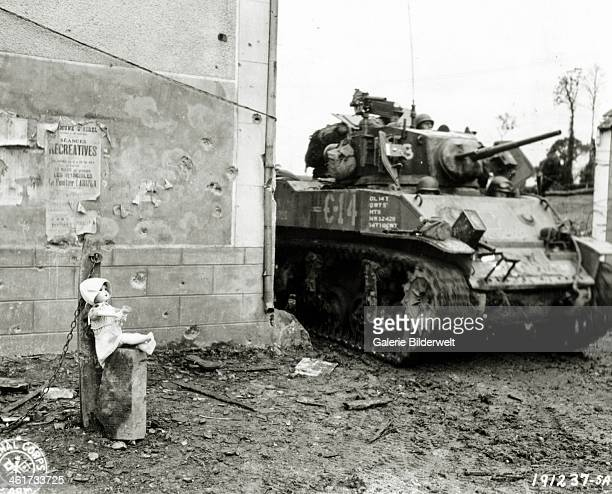An American tank of the 3rd Armored Division shows up in the Vauterie hamlet of SaintFromond June 1944 A doll has been placed on a stone next to a...